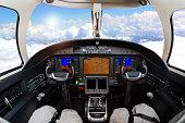 Cockpit view above clouds