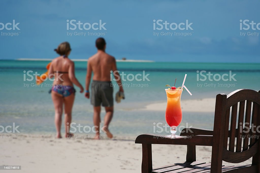 Cocktail and couple on the Maldives royalty-free stock photo