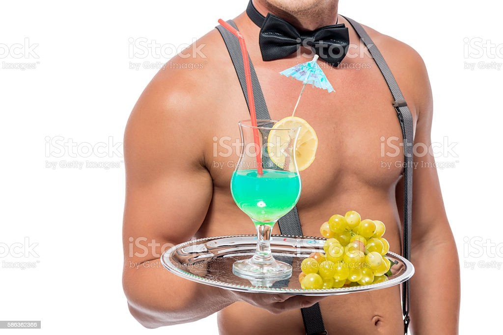 cocktail and grapes on a tray of the waiter closeup stock photo