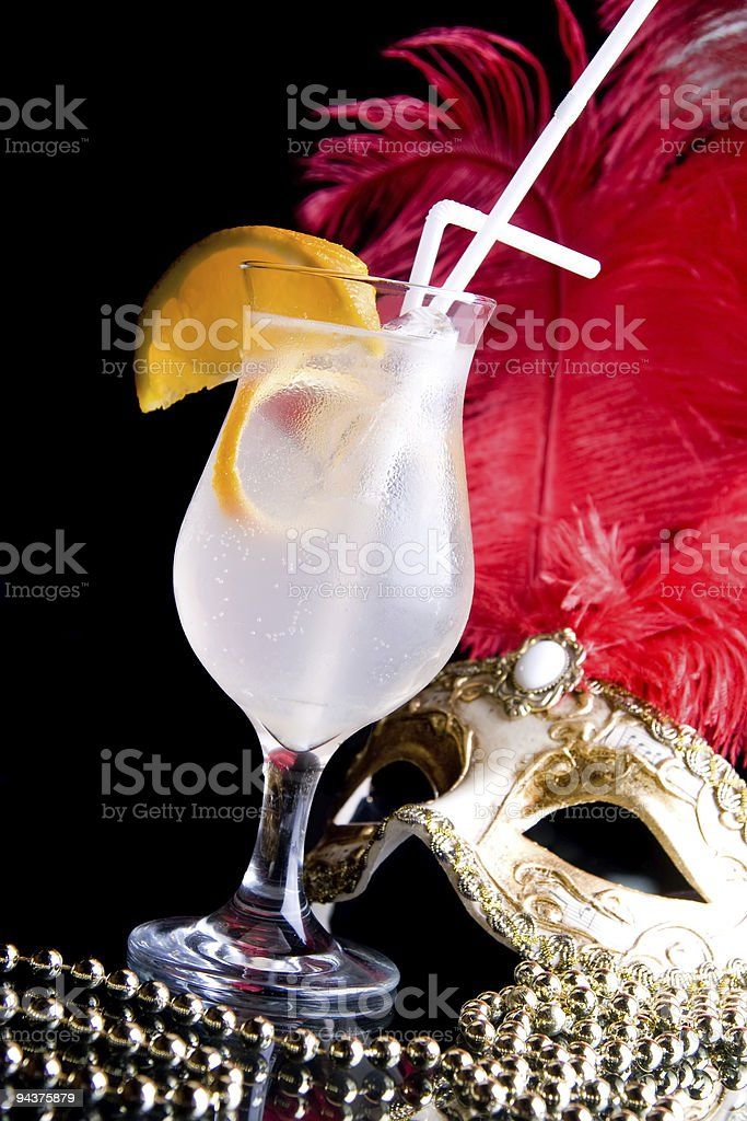 Cocktail and Venetian mask. royalty-free stock photo