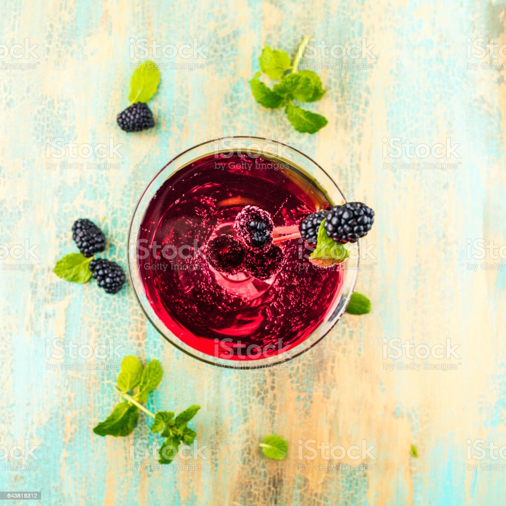 Cocktail drink for summer with blackberries and mint stock photo