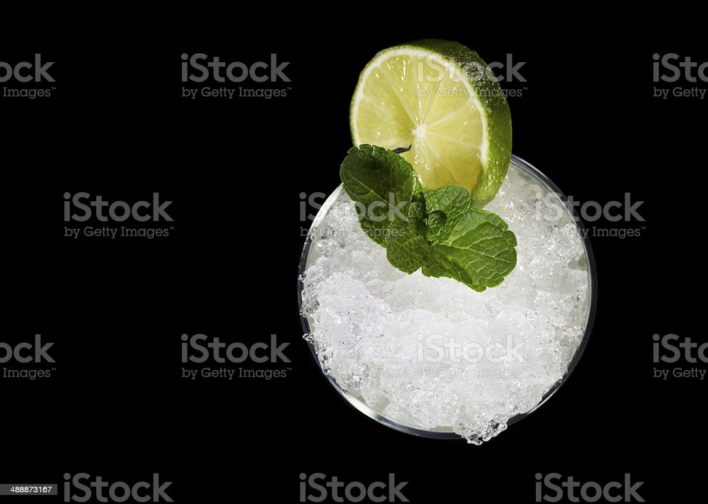 Cocktail Drink. Ice, Lemon, Lime and Menthe. Black Background. Close-up. stock photo