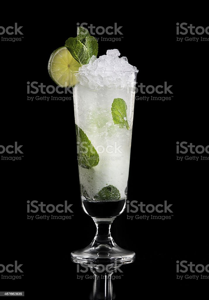 Cocktail Drink. Ice, Lemon, Lime and Menthe. Black Background. stock photo