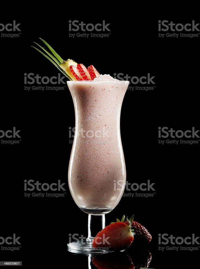 Cocktail Drink. Ice, Shake, Pineapple, Strawberry. Nonalcoholic. Black Background. royalty-free stock photo