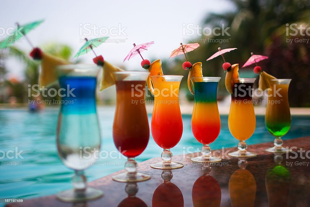 Cocktail Drinks Poolside in Row, Copy Space stock photo