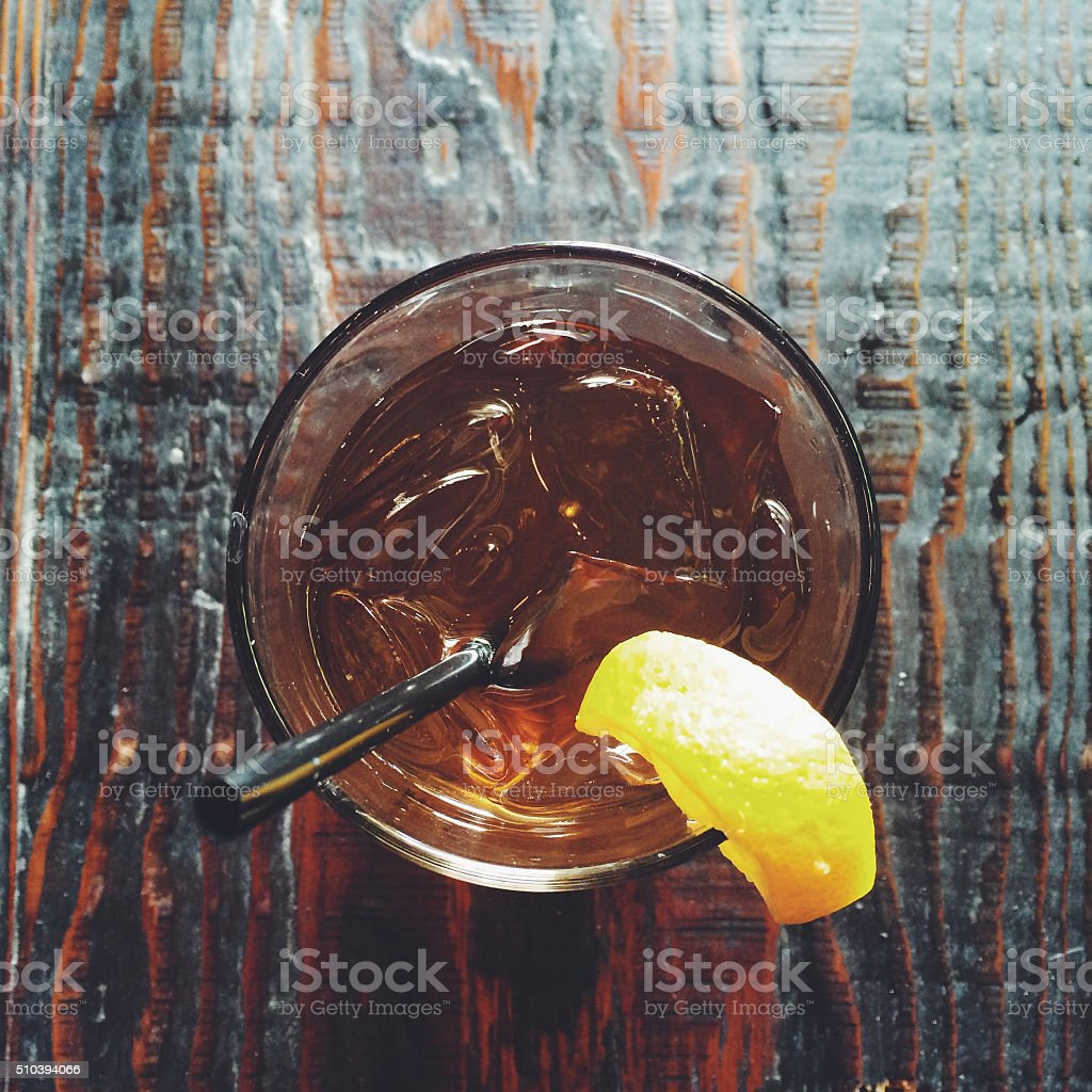 Cocktail glass on a wooden surface stock photo