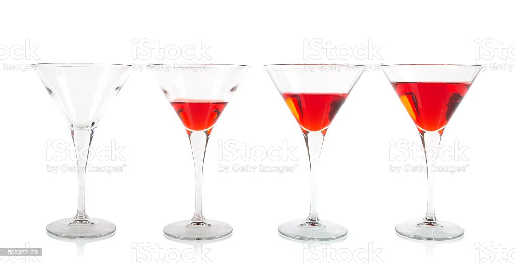 Cocktail glasses filled on different levels stock photo