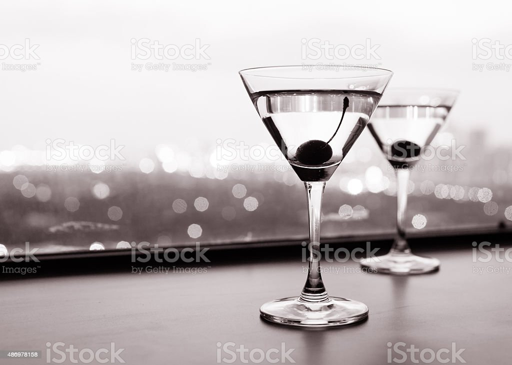 Cocktail glasses with city view stock photo