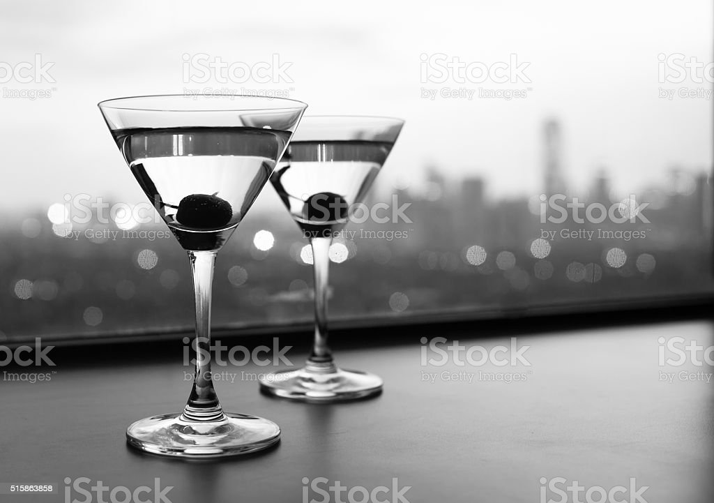 Cocktail glasses with city view. stock photo