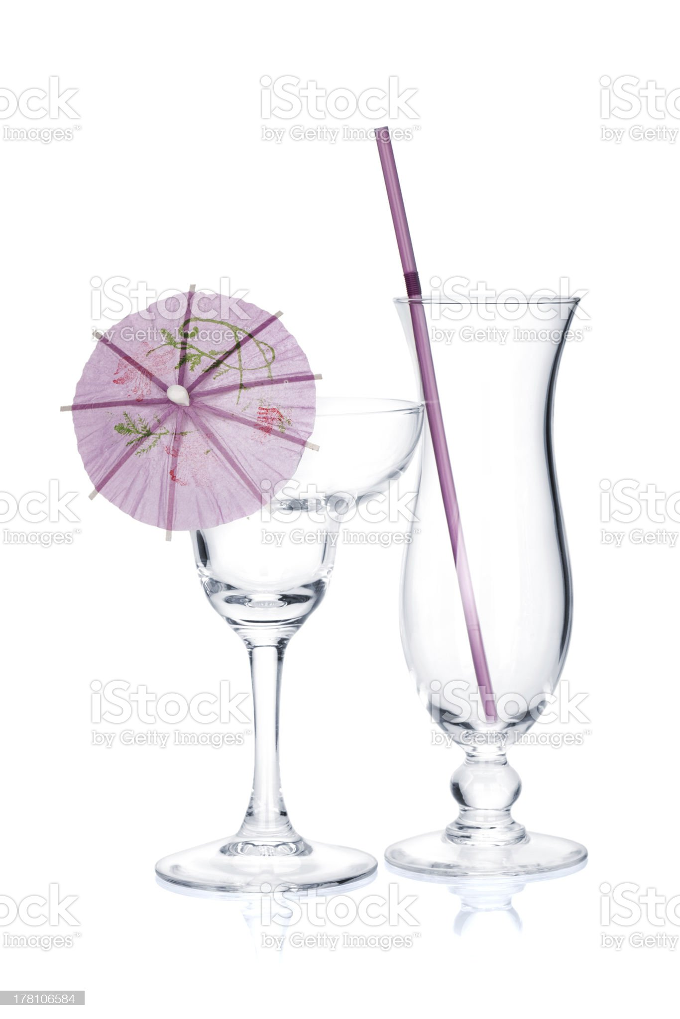 Cocktail glasses with drinking straw and umbrella royalty-free stock photo