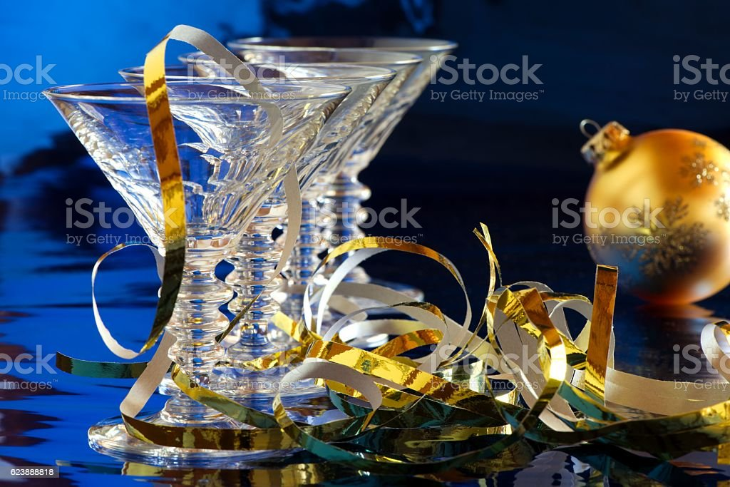 Cocktail glasses with golden Christmas decoration stock photo