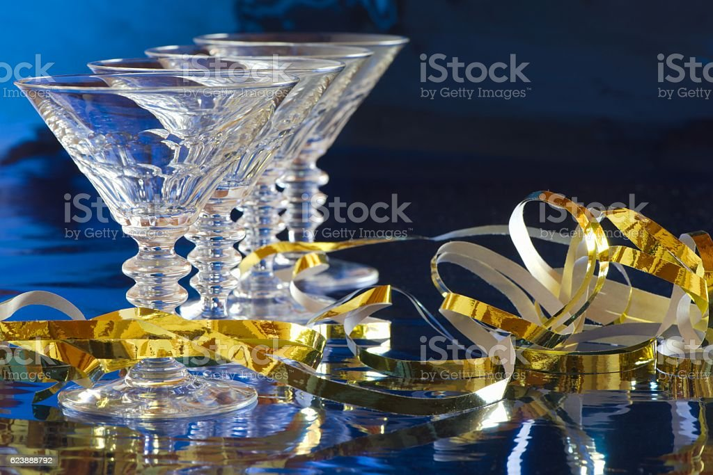 Cocktail glasses with golden serpentine stock photo