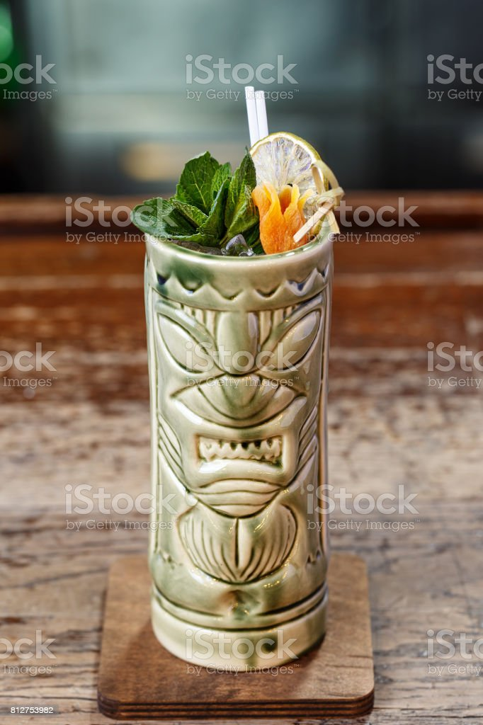 Cocktail in a glass of tiki stock photo