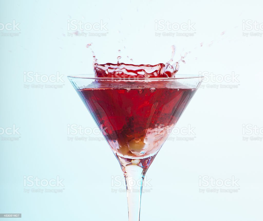 Cocktail in a martini glass and olive royalty-free stock photo