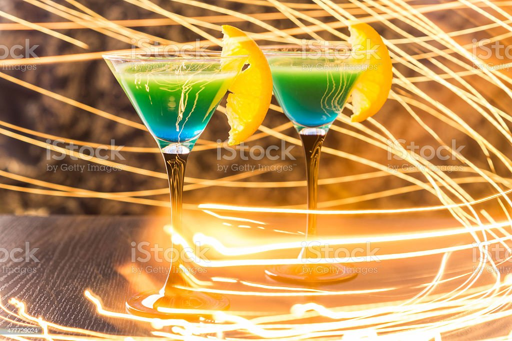 Cocktail in martini glass with sparks stock photo