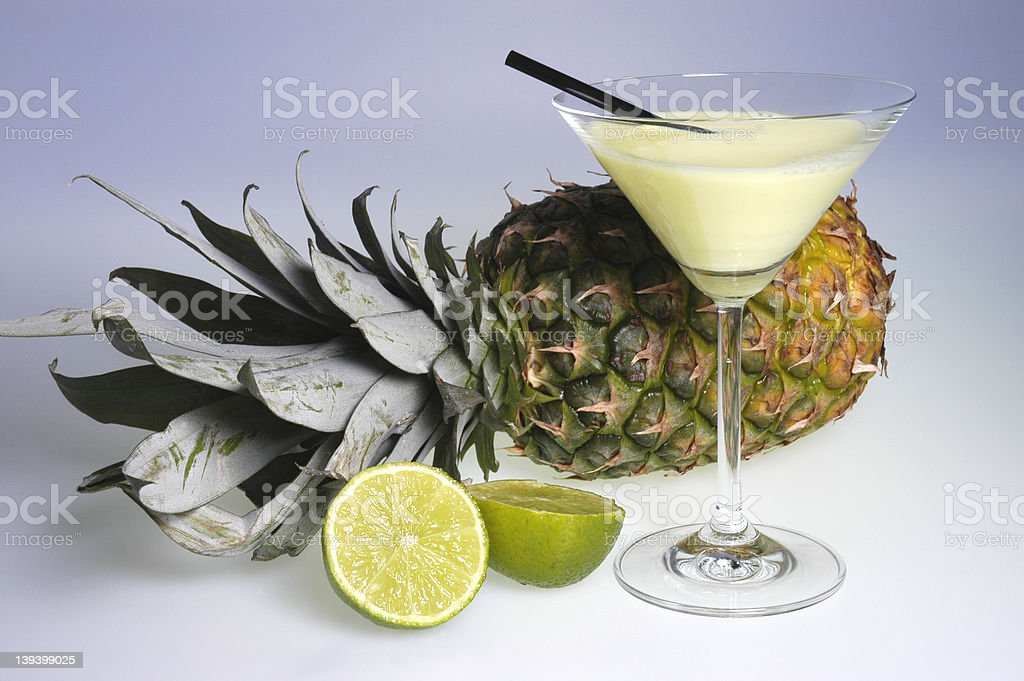 cocktail & limes & pineapple stock photo