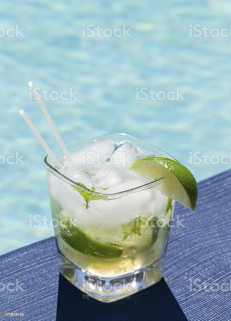 Cocktail Majito on edge by poolside stock photo