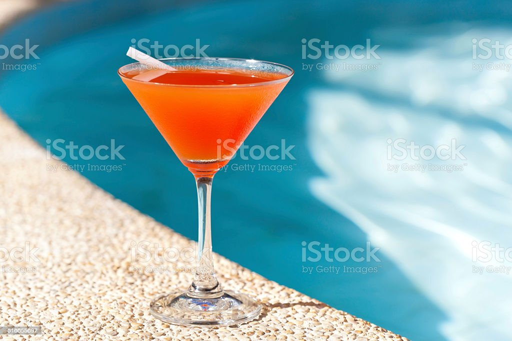Cocktail Margarita with ice near swimming pool stock photo