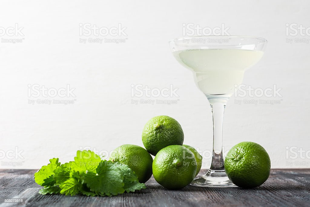 Cocktail margarita with limes and mint stock photo
