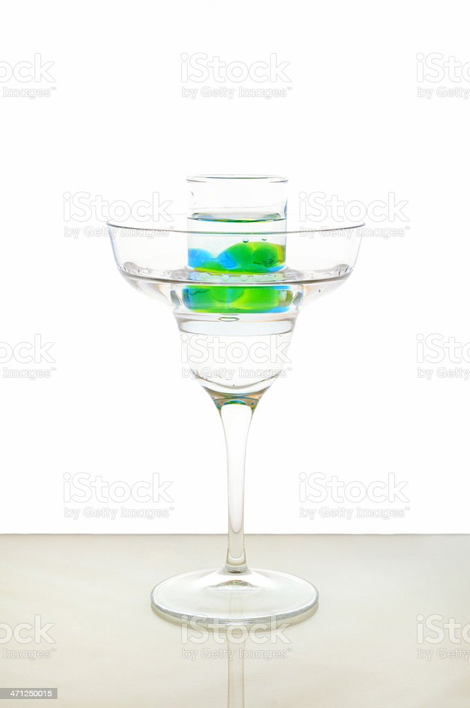 Cocktail Martini With Shot Of Midori And Blue Curacao Spherification stock photo