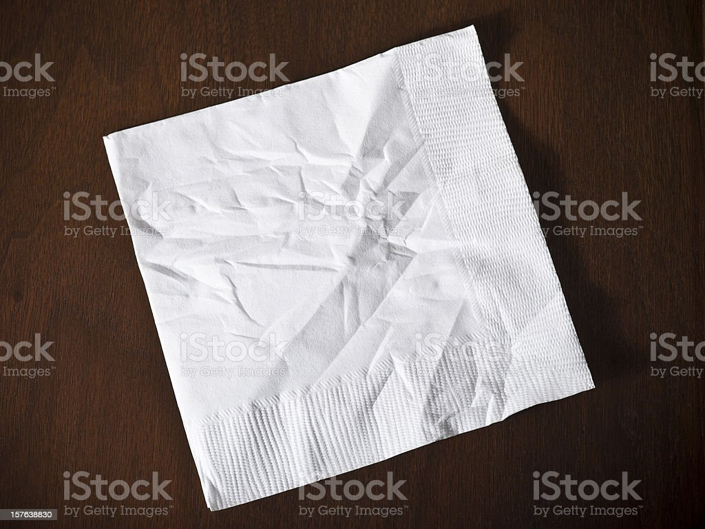 Cocktail napkin on wood stock photo