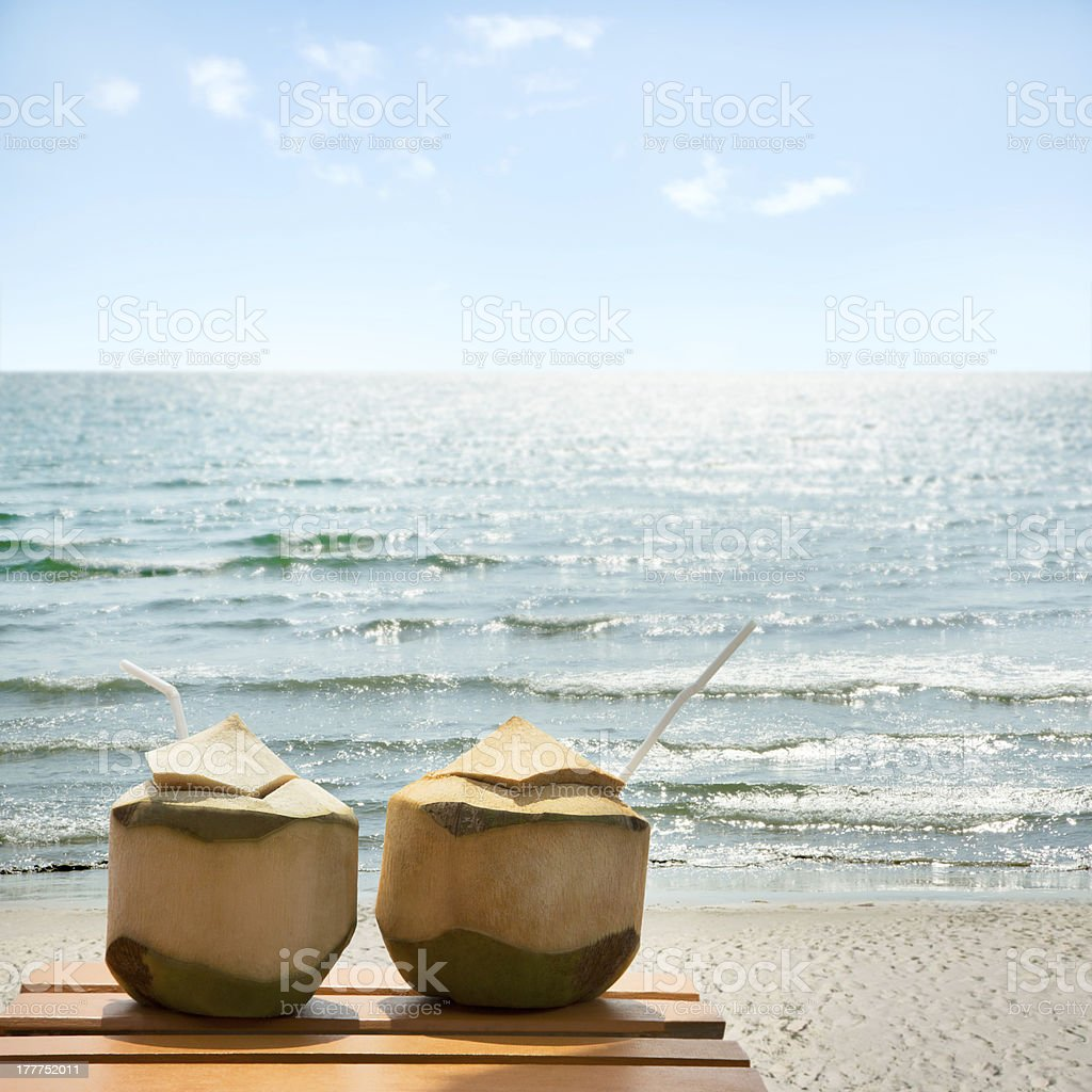 Cocktail of coconuts on the beach royalty-free stock photo