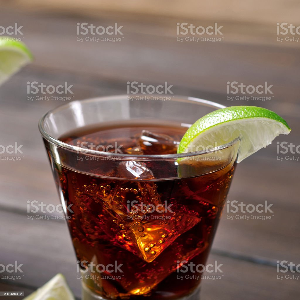 Cocktail rum and cola and ice stock photo