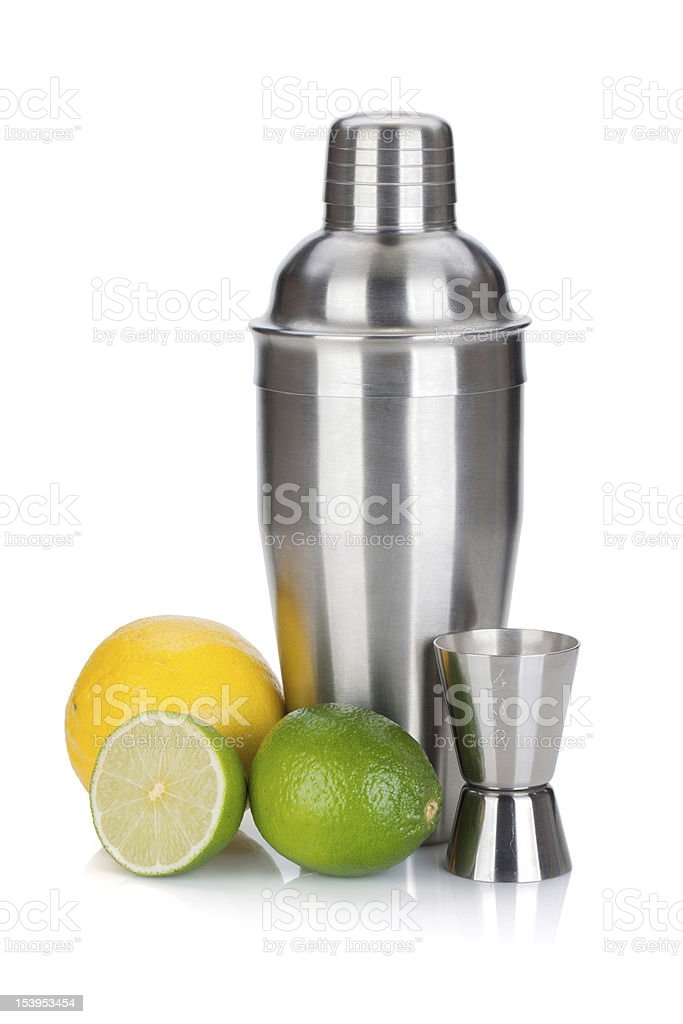 Cocktail shaker with measuring cup and citruses stock photo