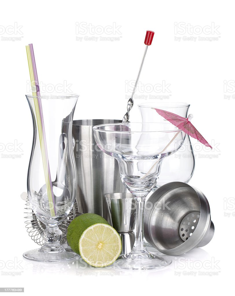 Cocktail shakers, glasses, utensils and lime royalty-free stock photo