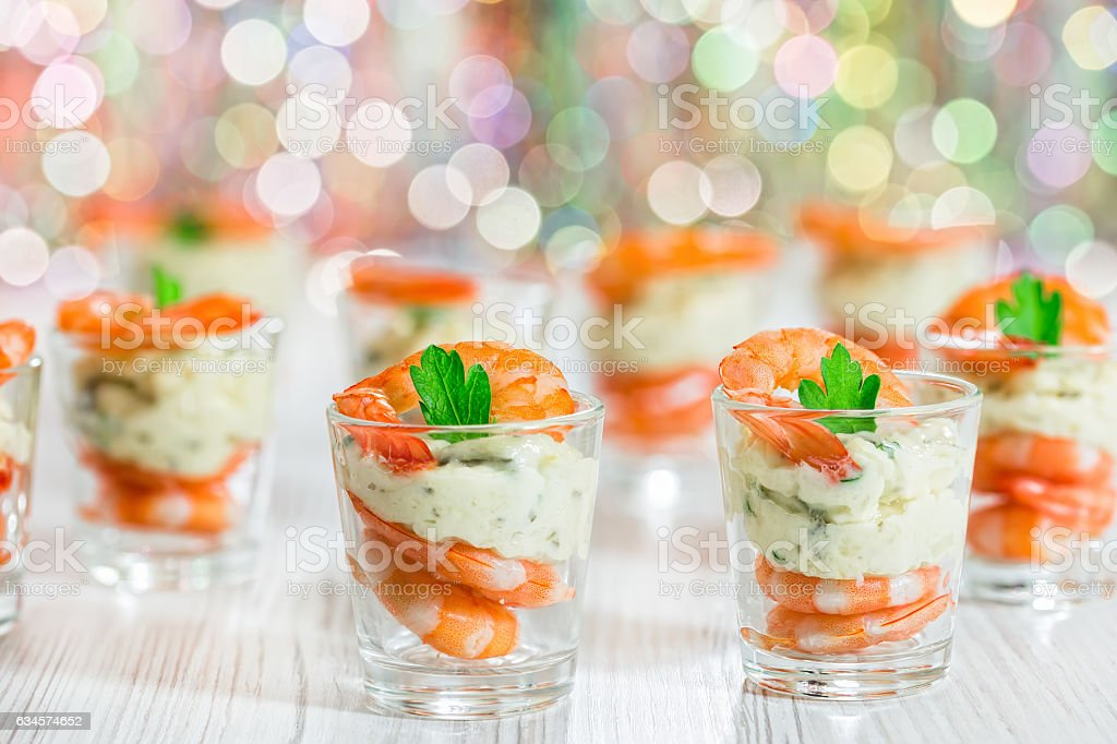 Cocktail Shrimp shot glasses with delicious homemade tartar spic stock photo