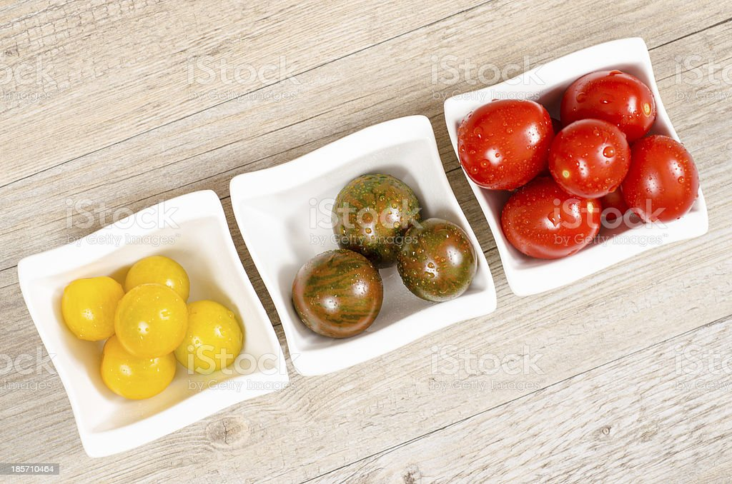 Cocktail tomatoes in yellow, green and red royalty-free stock photo