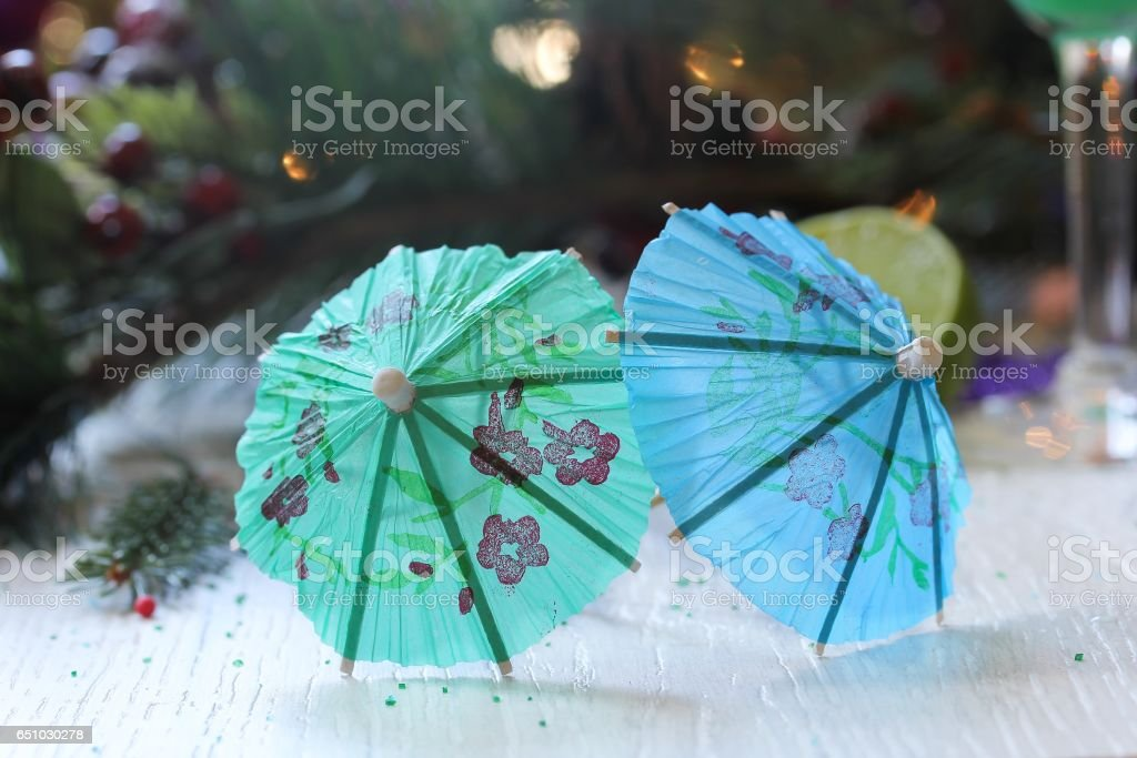 Cocktail umbrella on festive background, selective focus stock photo