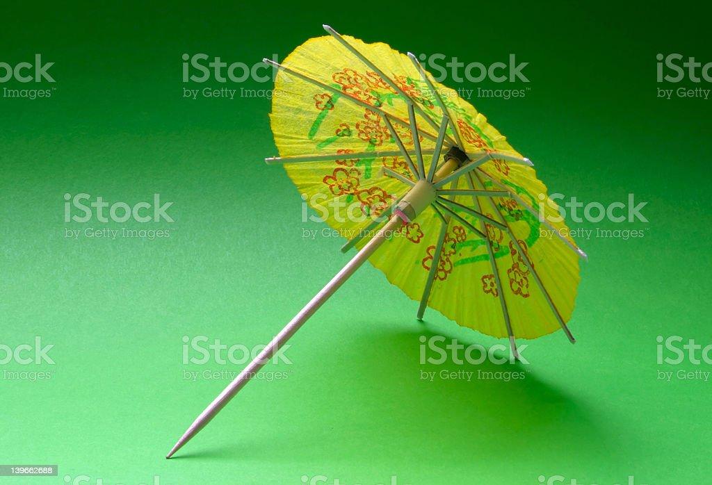 cocktail umbrella - yellow #1 royalty-free stock photo