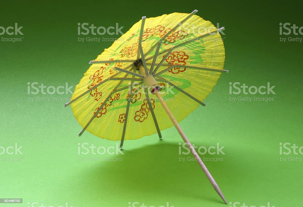 cocktail umbrella - yellow #2 royalty-free stock photo