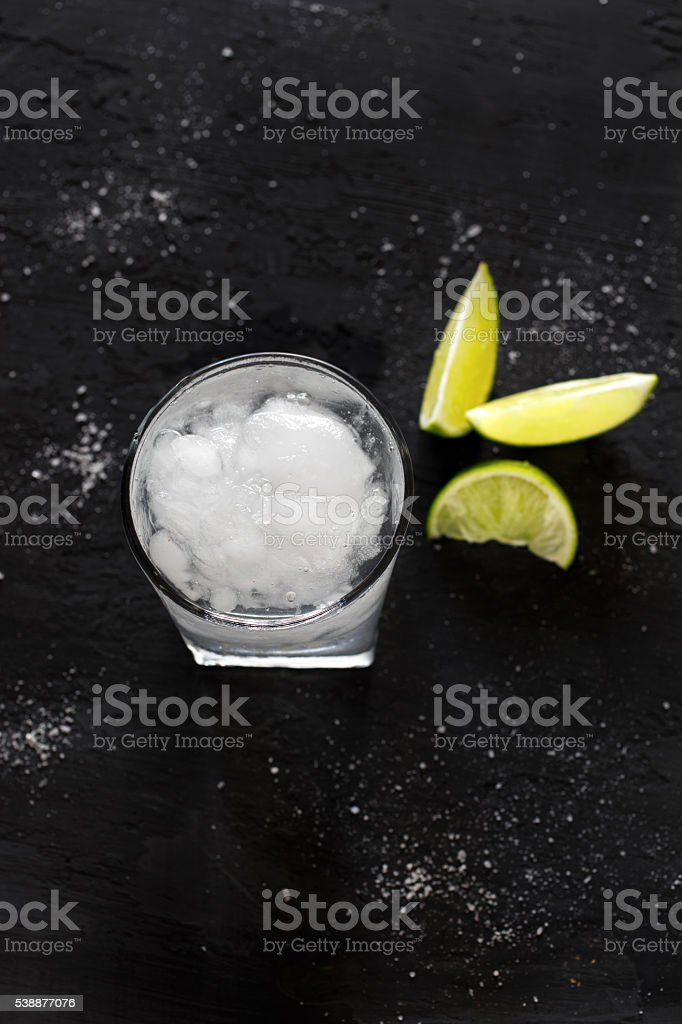 Cocktail vodka or gin with ice and lime stock photo