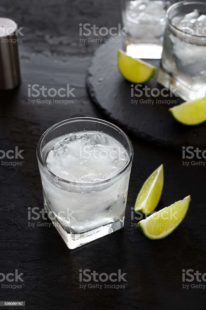 Cocktail vodka or gin with ice and slice lime stock photo
