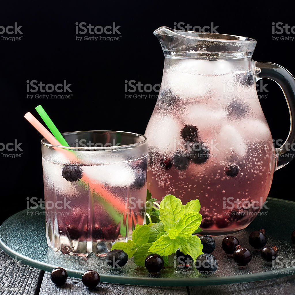 Cocktail with blueberry, black currant and ice stock photo