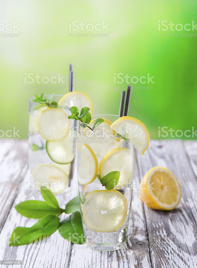 Cocktail with ice and lemon slices royalty-free stock photo