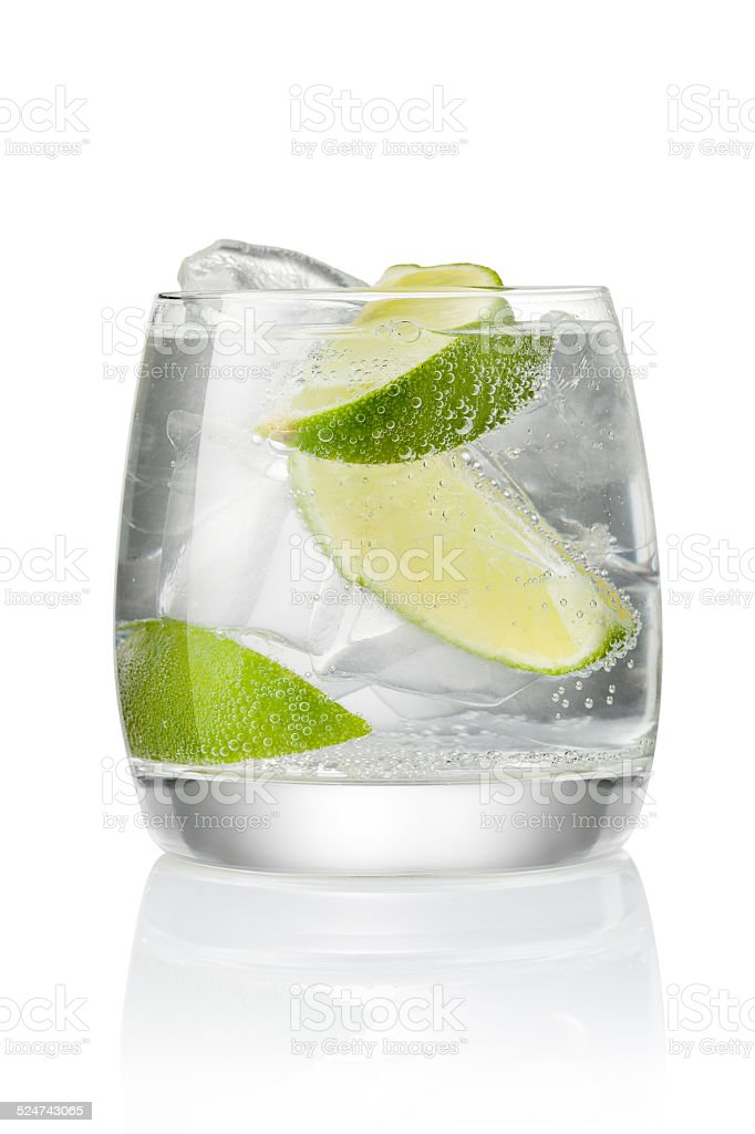 Cocktail with ice and lime stock photo