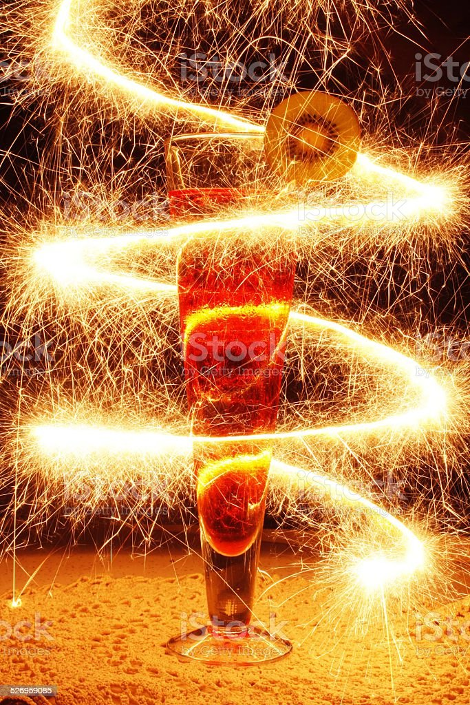 Cocktail with Kiwi Fruit and Sparkler Twist royalty-free stock photo