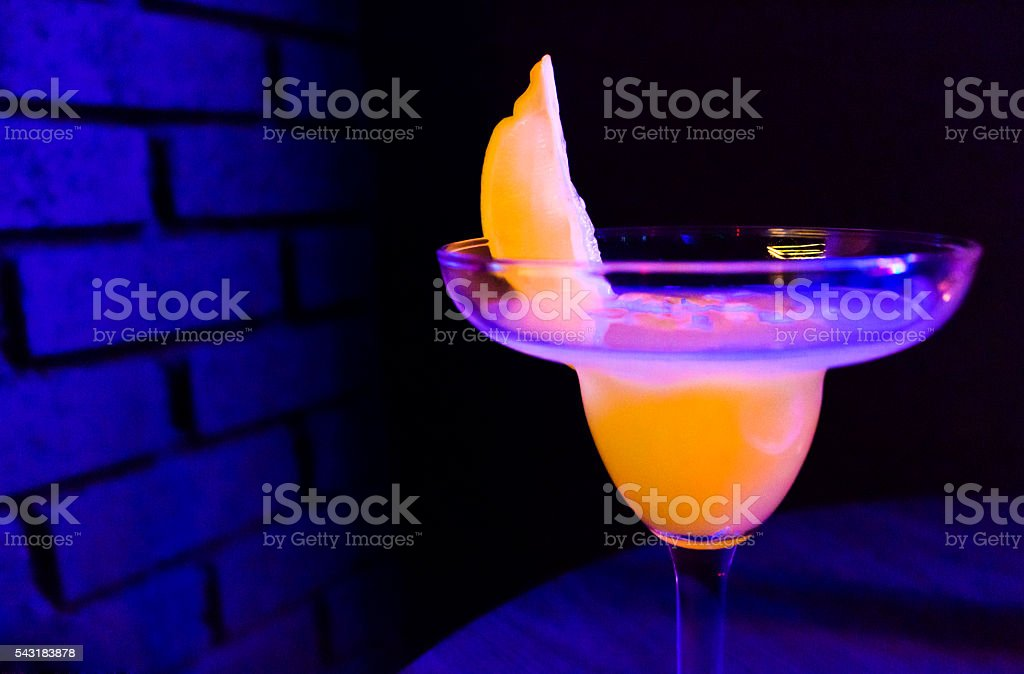Cocktail with lemon on table stock photo