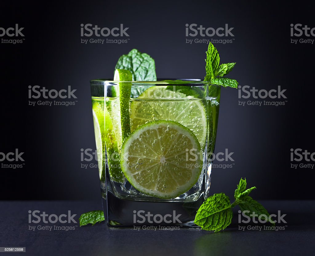 cocktail with lime and peppermint leaves stock photo
