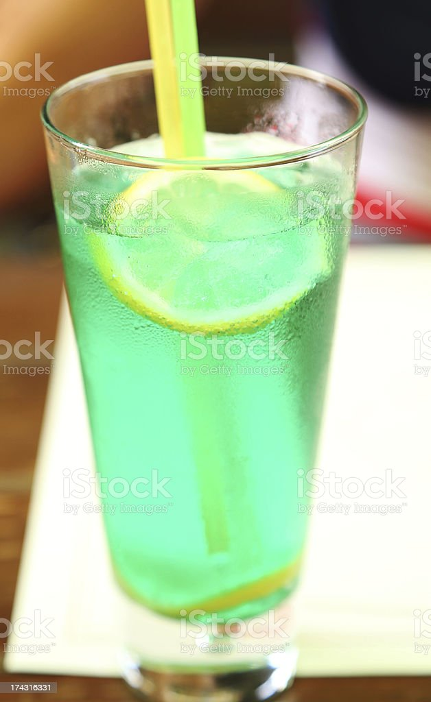 Cocktail with lime in wet glass. Close up. royalty-free stock photo