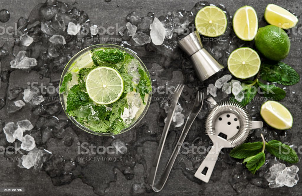 Cocktail with lime, mint and ice. Bar drink accessories stock photo