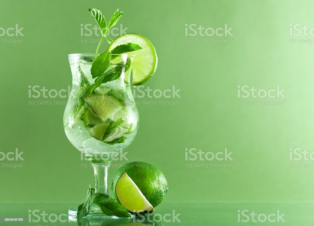 Cocktail with mint and lime stock photo