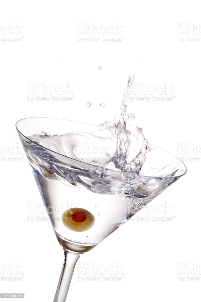 A cocktail with olive splashing royalty-free stock photo