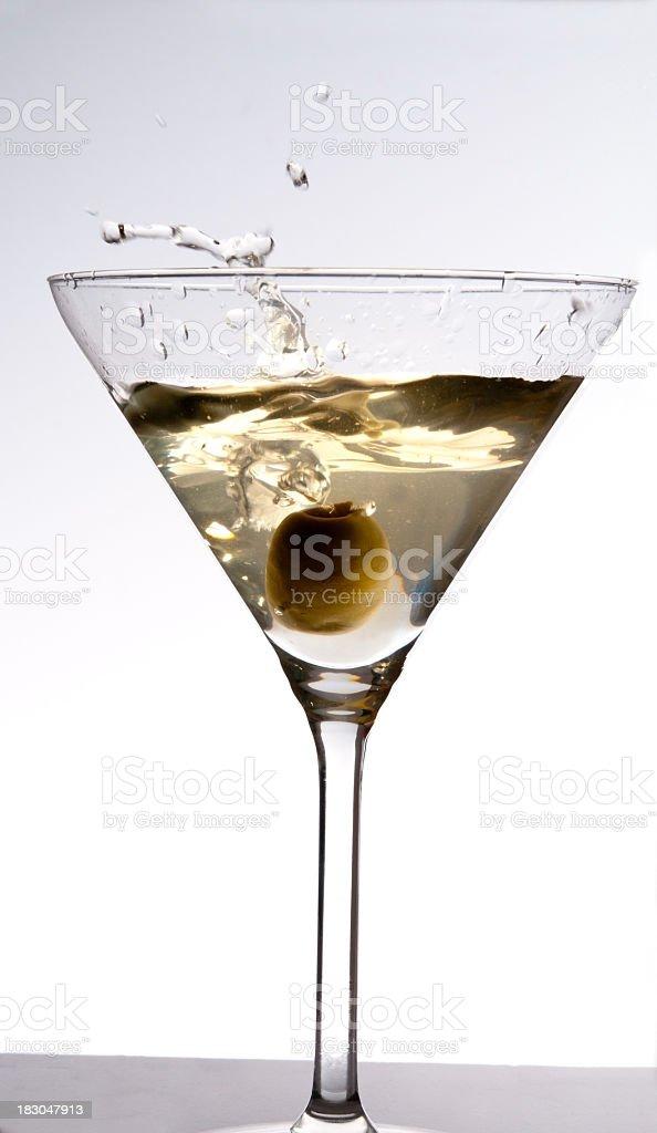 Cocktail with olive splashing stock photo