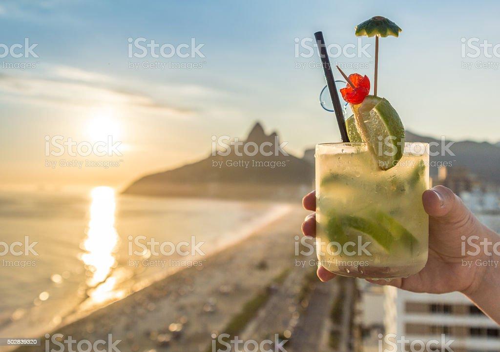Cocktail with Rio de Janeiro, Brazil beach background stock photo