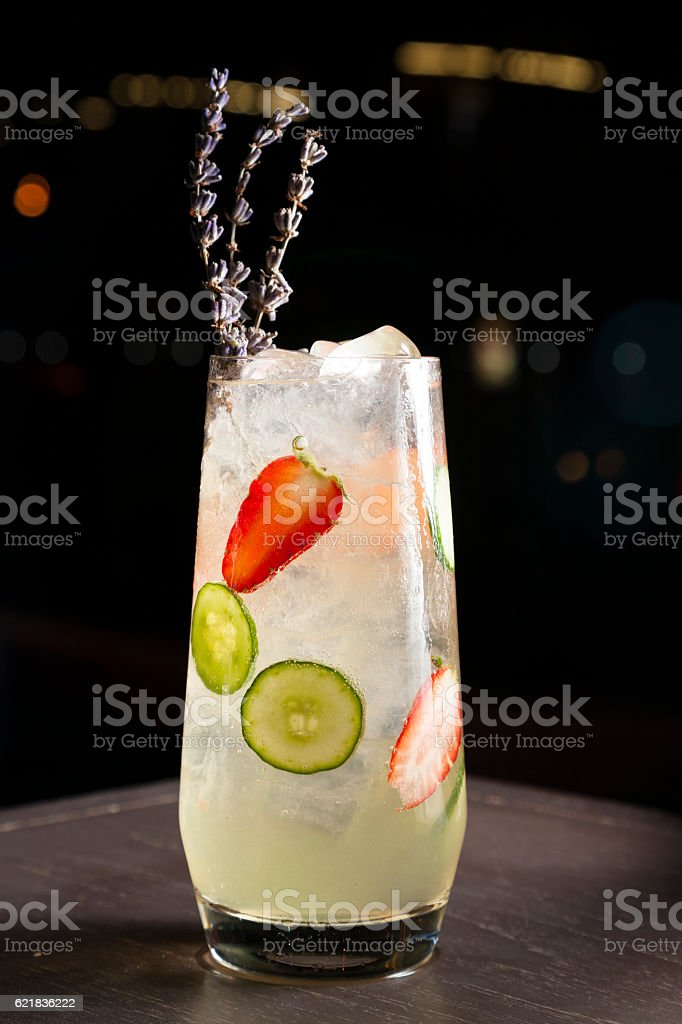 Cocktail with strawberry and cucumber stock photo