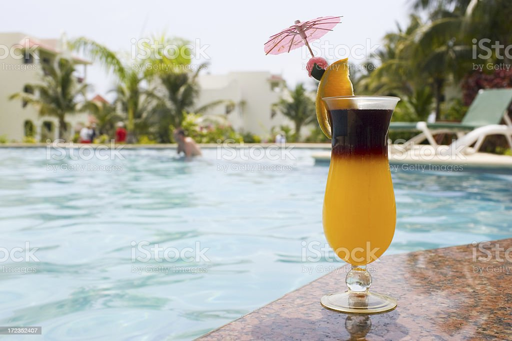 Cocktail with Umbrella at Tropical Resort Pool, Copy Space royalty-free stock photo
